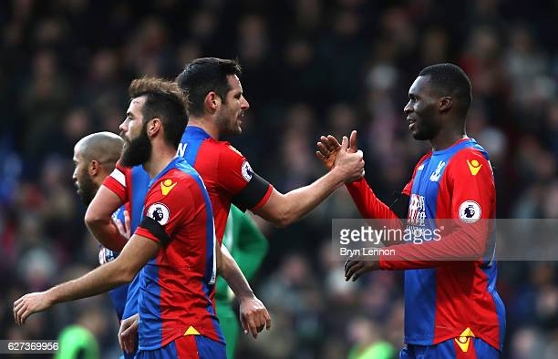Christian Benteke of Crystal Palace celebrates scoring the opening goal with his team mates during the Premier League match between Crystal Palace...
