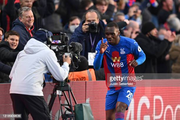 Christian Benteke of Crystal Palace celebrates to the TV camera after scoring his team's first goal during the Premier League match between Crystal...