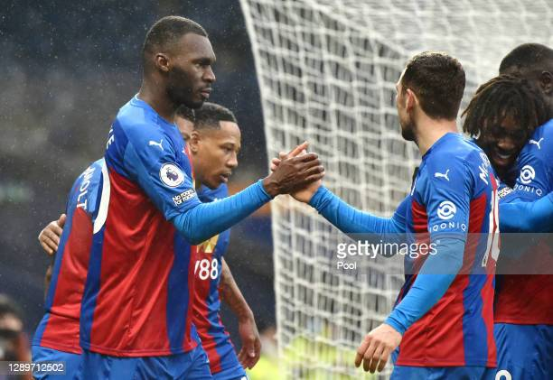Christian Benteke of Crystal Palace celebrates with James McArthur after scoring their team's third goal during the Premier League match between West...