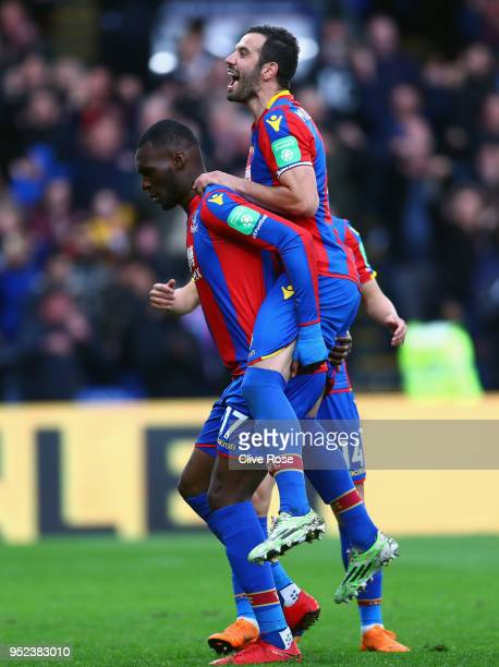 Christian Benteke of Crystal Palace celebrates with James Tomkins of Crystal Palace after scoring his sides fifth goal during the Premier League...