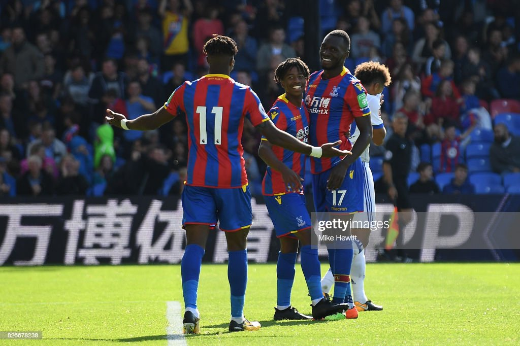 Christian Benteke of Crystal Palace (centre) celebrates with Wilfried Zaha (11) and Jason Lokilo after equalising during a Pre Season Friendly between Crystal Palace and FC Schalke 04 at Selhurst Park on August 5, 2017 in London, England.