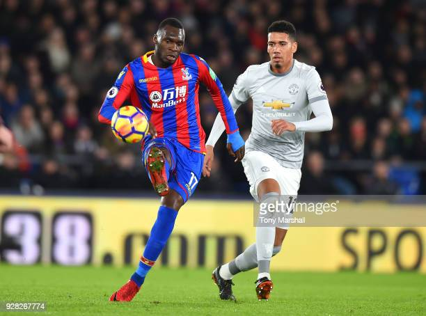 Christian Benteke of Crystal Palace challenged by Chris Smalling of Manchester United during the Premier League match between Crystal Palace and...