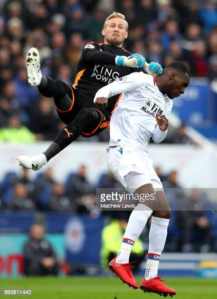Christian Benteke of Crystal Palace clashes with Kasper Schmeichel of Leicester City during the Premier League match between Leicester City and...