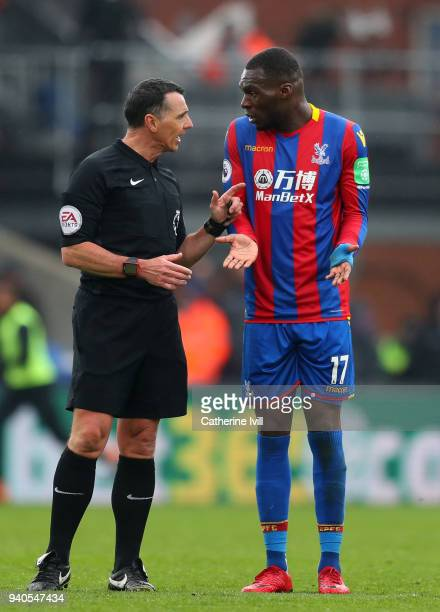 Christian Benteke of Crystal Palace confronts referee Neil Swarbrick during the Premier League match between Crystal Palace and Liverpool at Selhurst...