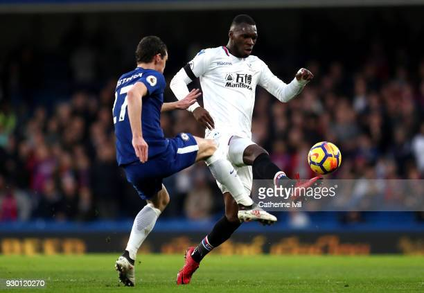 Christian Benteke of Crystal Palace controls the ball ahead of Andreas Christensen of Chelsea during the Premier League match between Chelsea and...
