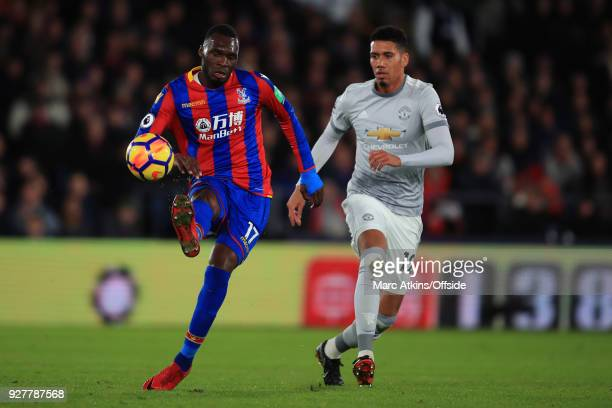 Christian Benteke of Crystal Palace in action with Chris Smalling of Manchester United during the Premier League match between Crystal Palace and...