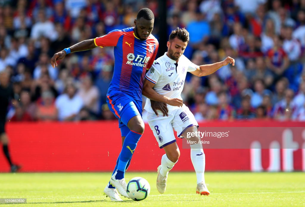 Christian Benteke of Crystal Palace in action with Corentin Jean of Toulouse during the Pre-Season Friendly between Crystal Palace and Toulouse at Selhurst Park on August 4, 2018 in London, England.
