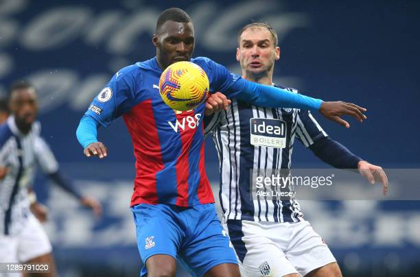 Christian Benteke of Crystal Palace is challenged by Branislav Ivanovic of West Bromwich Albion during the Premier League match between West Bromwich...