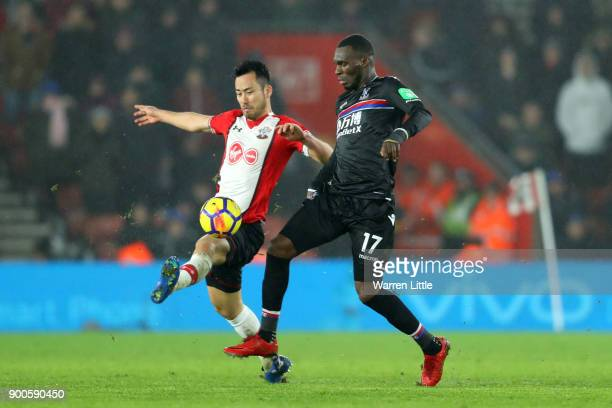 Christian Benteke of Crystal Palace is challenged by Maya Yoshida of Southampton during the Premier League match between Southampton and Crystal...