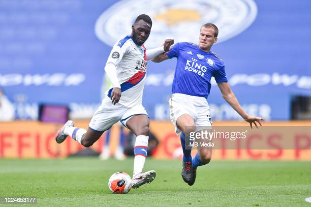 Christian Benteke of Crystal Palace is challenged by Ryan Bennett of Leicester City during the Premier League match between Leicester City and...