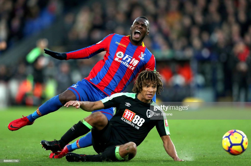 Christian Benteke of Crystal Palace is fouled by Nathan Ake of AFC Bournemouth during the Premier League match between Crystal Palace and AFC Bournemouth at Selhurst Park on December 9, 2017 in London, England.