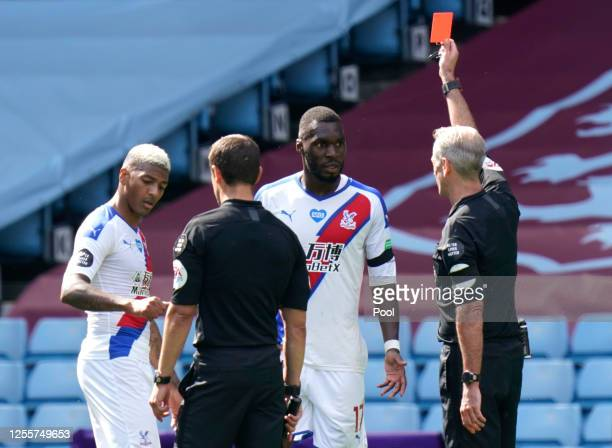 Christian Benteke of Crystal Palace is shown the red card by the match referee during the Premier League match between Aston Villa and Crystal Palace...