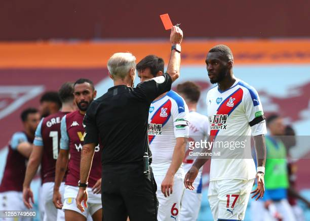 Christian Benteke of Crystal Palace is shown the red card during the Premier League match between Aston Villa and Crystal Palace at Villa Park on...