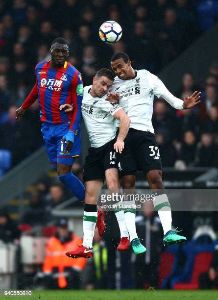Christian Benteke of Crystal Palace Jordan Henderson of Liverpool and Joel Matip of Liverpool battle for possession during the Premier League match...