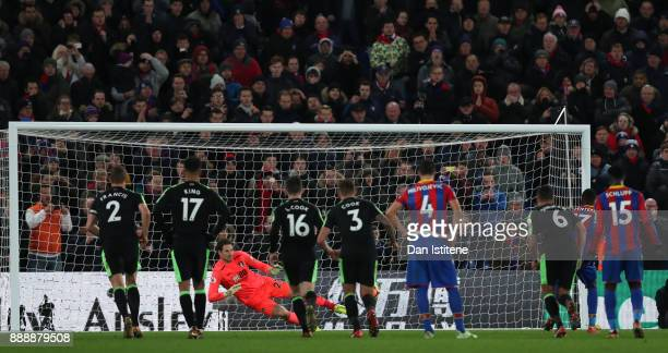 Christian Benteke of Crystal Palace misses a penalty during the Premier League match between Crystal Palace and AFC Bournemouth at Selhurst Park on...