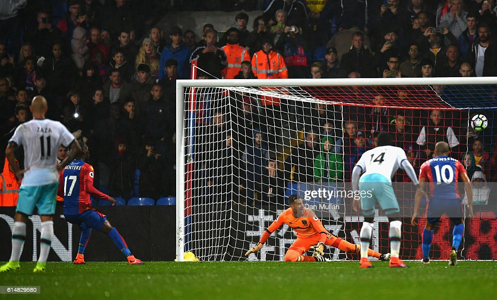 Christian Benteke of Crystal Palace misses from the penalty spot during the Premier League match between Crystal Palace and West Ham United at Selhurst Park on October 15, 2016 in London, England.