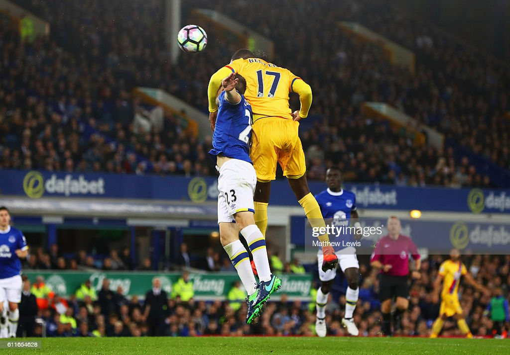 Christian Benteke of Crystal Palace outjumps Seamus Coleman of Everton as he scores their first goal during the Premier League match between Everton and Crystal Palace at Goodison Park on September 30, 2016 in Liverpool, England.