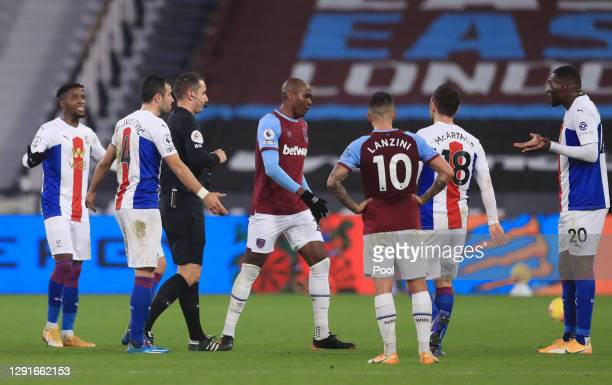 Christian Benteke of Crystal Palace reacts after being sent off for a second yellow card by match referee David Coote during the Premier League match...