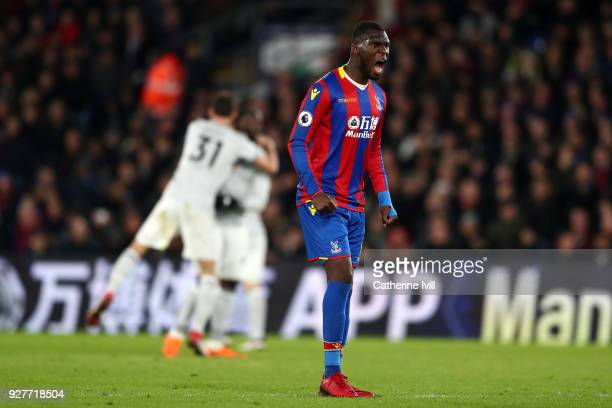 Christian Benteke of Crystal Palace reacts after Manchester United scored there 2nd goal during the Premier League match between Crystal Palace and...