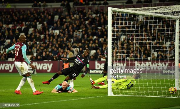 Christian Benteke of Crystal Palace scores his sides first goal during the Premier League match between West Ham United and Crystal Palace at London...