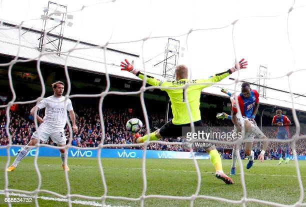 Christian Benteke of Crystal Palace scores his sides second goal past Kasper Schmeichel of Leicester City during the Premier League match between...