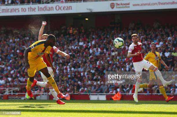 Christian Benteke of Crystal Palace scores his team's first goal during the Premier League match between Arsenal FC and Crystal Palace at Emirates...