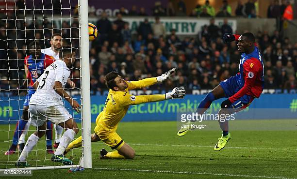 Christian Benteke of Crystal Palace scores his team's fourth goal during the Premier League match between Swansea City and Crystal Palace at Liberty...
