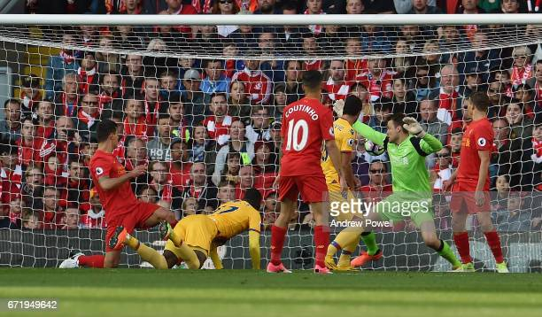 Christian Benteke of Crystal Palace scores the second goal during the Premier League match between Liverpool and Crystal Palace at Anfield on April...
