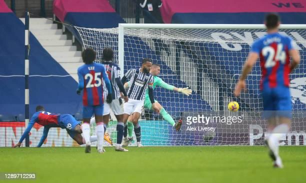 Christian Benteke of Crystal Palace scores their team's third goal past Sam Johnstone and Kyle Bartley of West Bromwich Albion during the Premier...