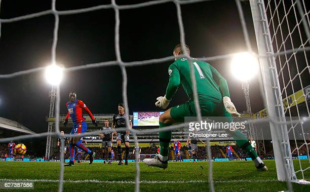 Christian Benteke of Crystal Palace scores their third goal past goalkeeper Fraser Forster of Southampton during the Premier League match between...
