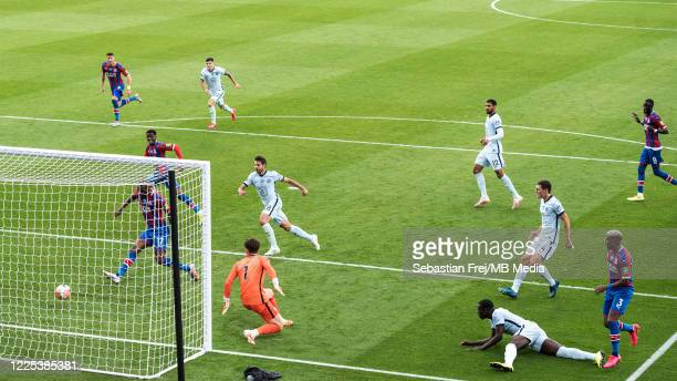Christian Benteke of Crystal Palace scoring goal during the Premier League match between Crystal Palace and Chelsea FC at Selhurst Park on July 7...