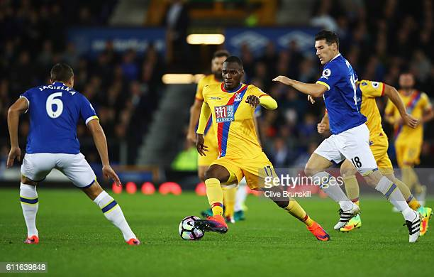 Christian Benteke of Crystal Palace takes on Phil Jagielka and Gareth Barry of Everton during the Premier League match between Everton and Crystal...