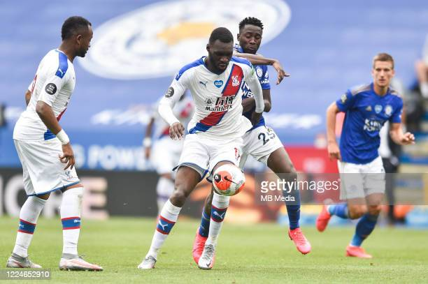 Christian Benteke of Crystal Palace tries to control the ball ahead of Wilfred Ndidi of Leicester City during the Premier League match between...