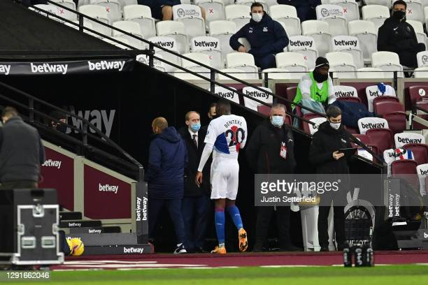Christian Benteke of Crystal Palace walks off the pitch after being sent off for a second yellow card during the Premier League match between West...