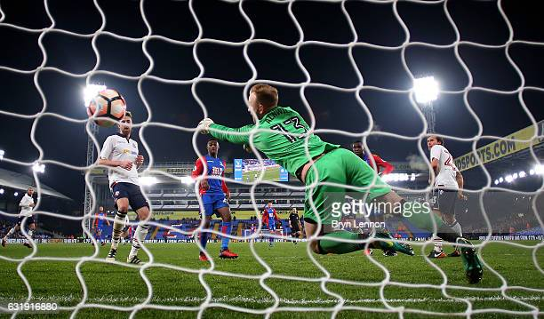 Christian Benteke of Crystal Palacescores his sides second goal past Ben Alnwick of Bolton during the Emirates FA Cup third round replay between...