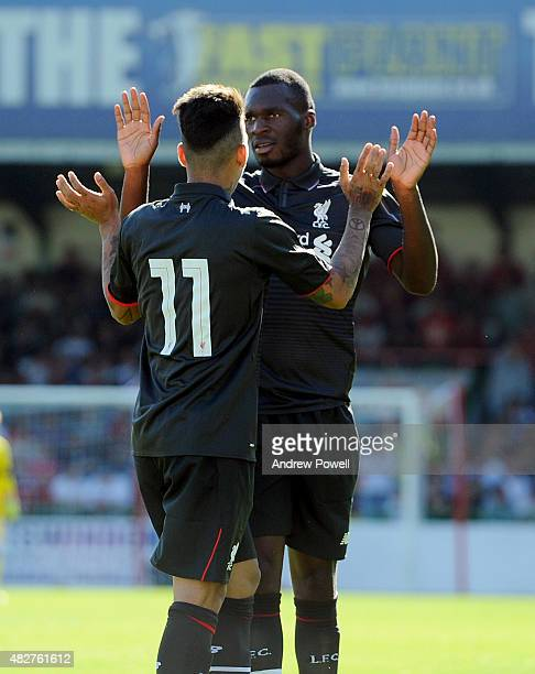 Christian Benteke of Liverpool celebrates after scoring the opening goal during a preseason friendly at County Ground on August 2 2015 in Swindon...