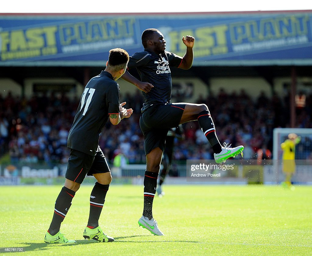 Christian Benteke of Liverpool celebrates after scoring the opening goal during a preseason friendly at County Ground on August 2, 2015 in Swindon, England.