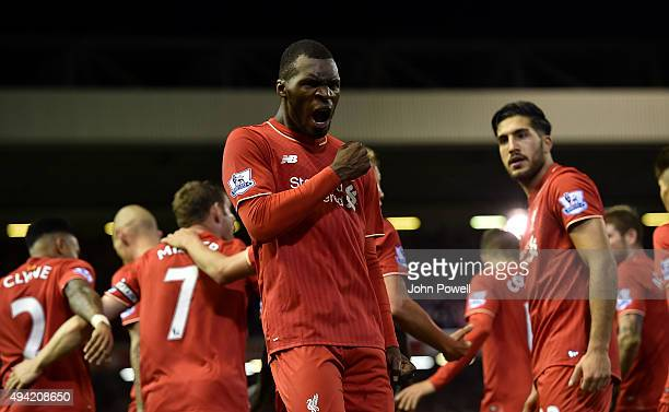 Christian Benteke of Liverpool celebrates his goal during the Barclays Premier League match between Liverpool and Southampton at Anfield on October...