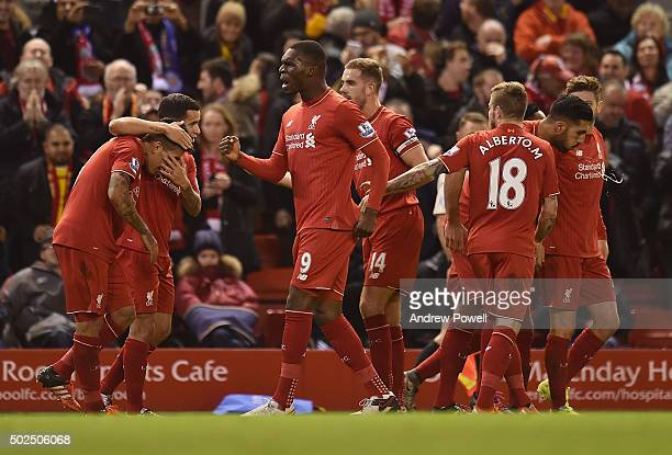 Christian Benteke of Liverpool celebrates his goal during the Barclays Premier League match between Liverpool and Leicester City at Anfield on...
