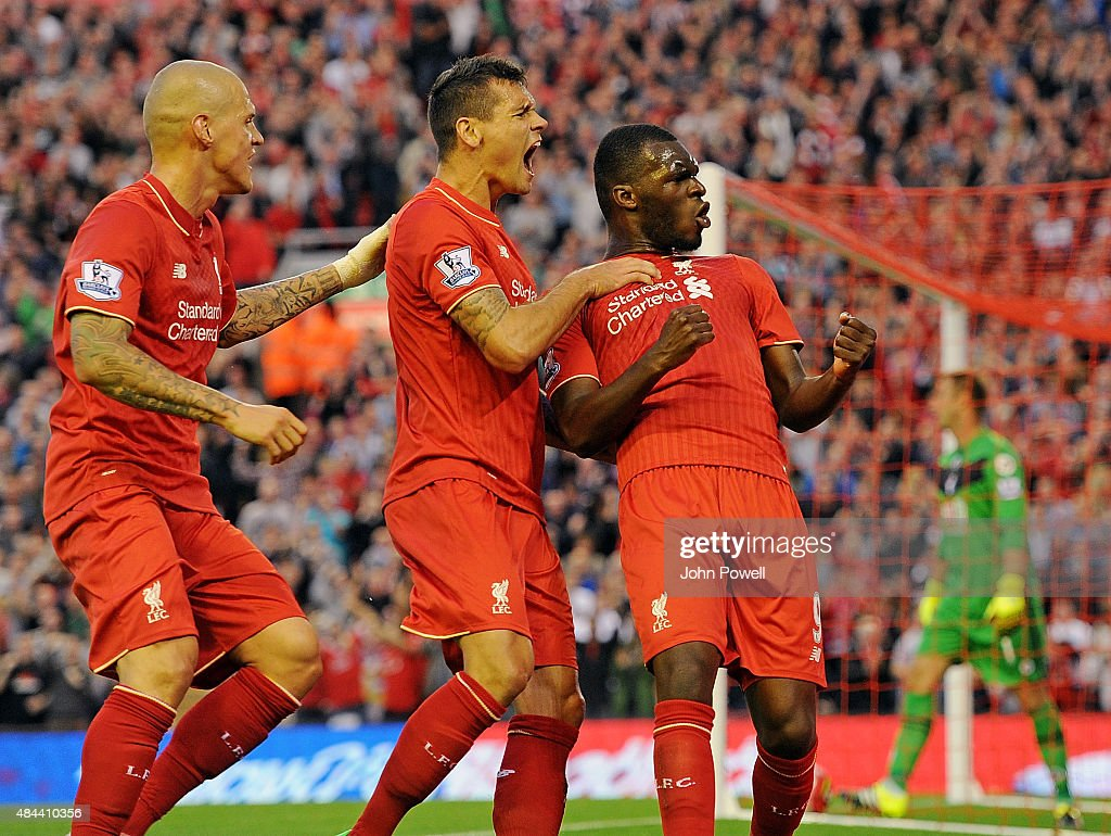 Christian Benteke of Liverpool celebrates his goal with his team mates Martin Skrtel and Dejan Lovren during the Barclays Premier League match between Liverpool and A.F.C. Bournemouth on August 17, 2015 in Liverpool, United Kingdom.
