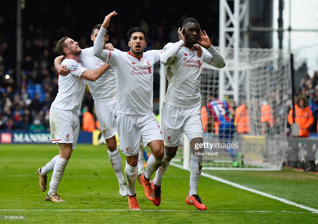 Christian Benteke of Liverpool (R) celebrates with team mates as he scores their second goal from the penalty spot during the Barclays Premier League match between Crystal Palace and Liverpool at Selhurst Park on March 6, 2016 in London, England.