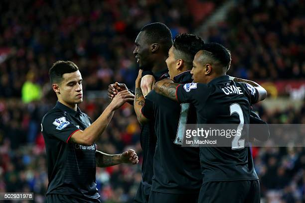 Christian Benteke of Liverpool celebrates with teammates Adam Lallana Philippe Coutinho and Roberto Firmino of Liverpool during the Barclays Premier...