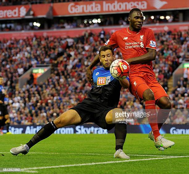 Christian Benteke of Liverpool competes with Tommy Elphick of AFC Bournemouth during the Barclays Premier League match between Liverpool and AFC...