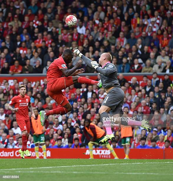 Christian Benteke of Liverpool has his effort saved by John Ruddy of Norwich City during the Barclays Premier League match between Liverpool and...