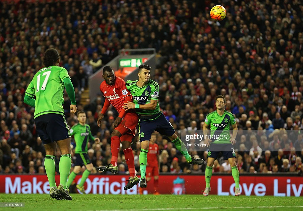 Christian Benteke of Liverpool heads the ball to score his team's first goal during the Barclays Premier League match between Liverpool and Southampton at Anfield on October 25, 2015 in Liverpool, England.