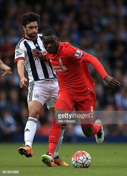 Christian Benteke of Liverpool holds off the challenge of Claudio Yacob of West Brom during the Barclays Premier League match between West Bromwich...