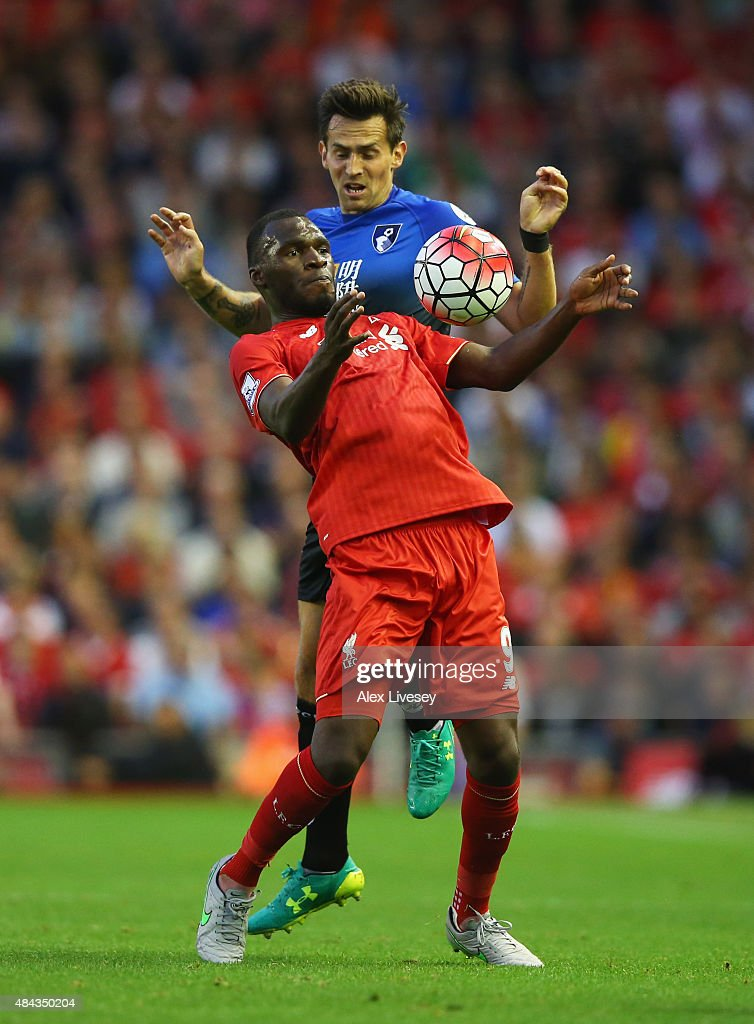 Christian Benteke of Liverpool is challenged by Charlie Daniels of Bournemouth during the Barclays Premier League match between Liverpool and A.F.C. Bournemouth at Anfield on August 17, 2015 in Liverpool, United Kingdom.