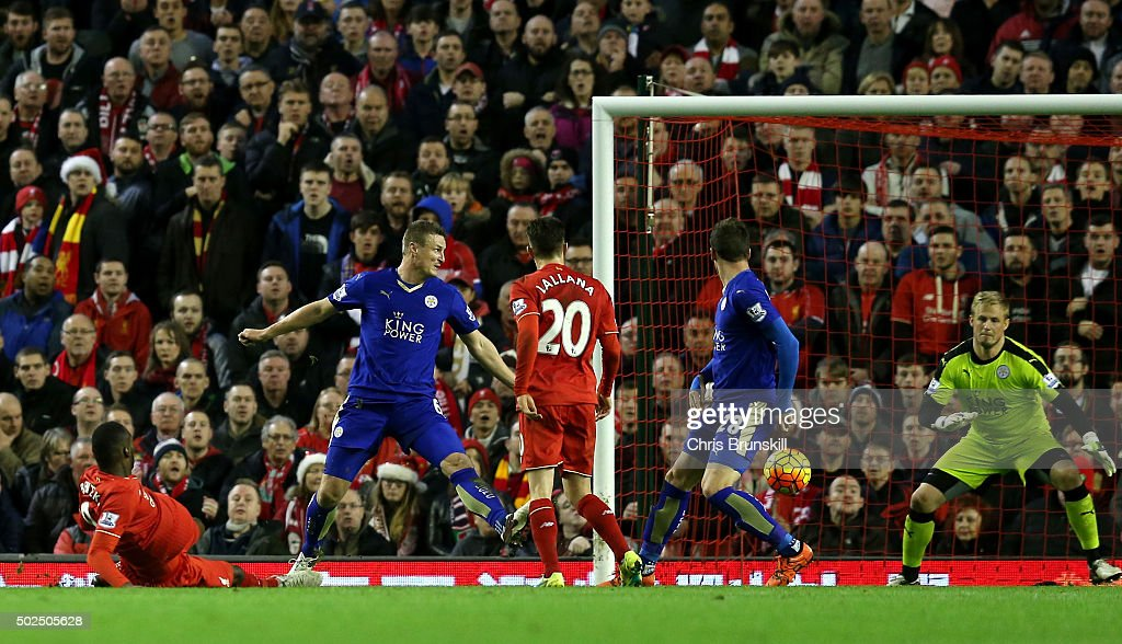 Christian Benteke of Liverpool (L) scores his side's first goal past Kasper Schmeichel of Leicester City (r) during the Barclays Premier League match between Liverpool and Leicester City at Anfield on December 26, 2015 in Liverpool, England.