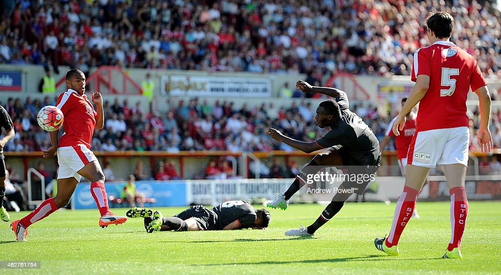 Christian Benteke of Liverpool scores the opening goal during a preseason friendly at County Ground on August 2, 2015 in Swindon, England.