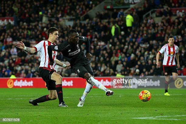 Christian Benteke of Liverpool scores the opening goal during the Barclays Premier League match between Sunderland and Liverpool at Stadium of Light...